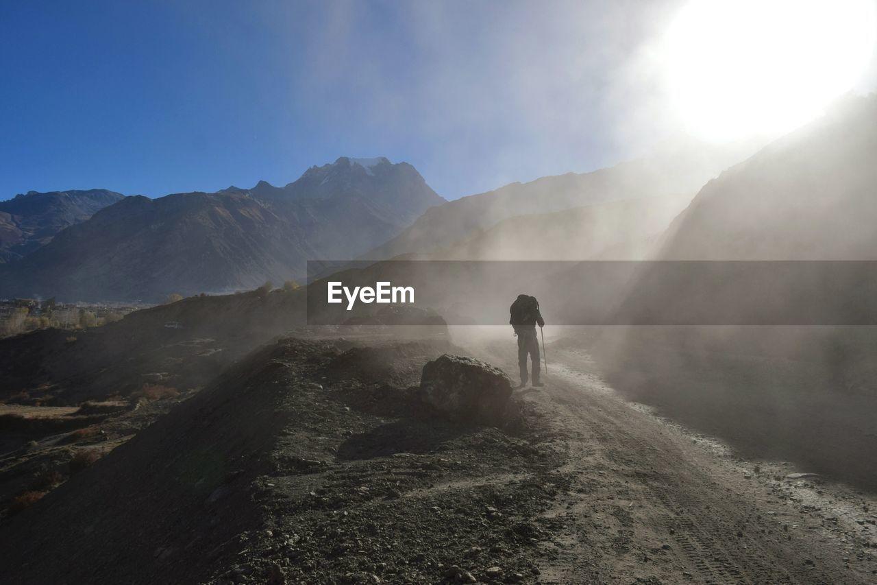 Hiker on mountain against sky