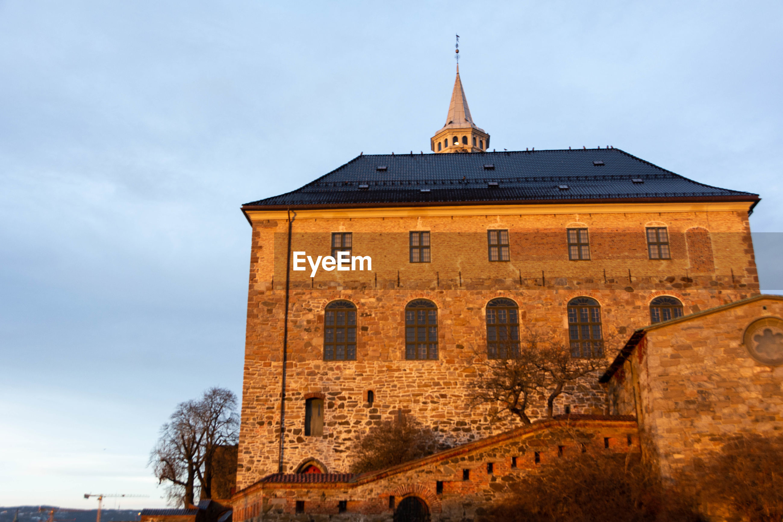 Low angle view of akershus fortress against sky