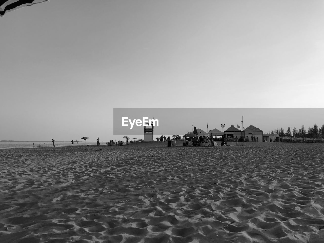 sky, beach, sand, land, built structure, nature, architecture, scenics - nature, building exterior, day, water, sea, tranquility, copy space, beauty in nature, tranquil scene, incidental people, building, outdoors