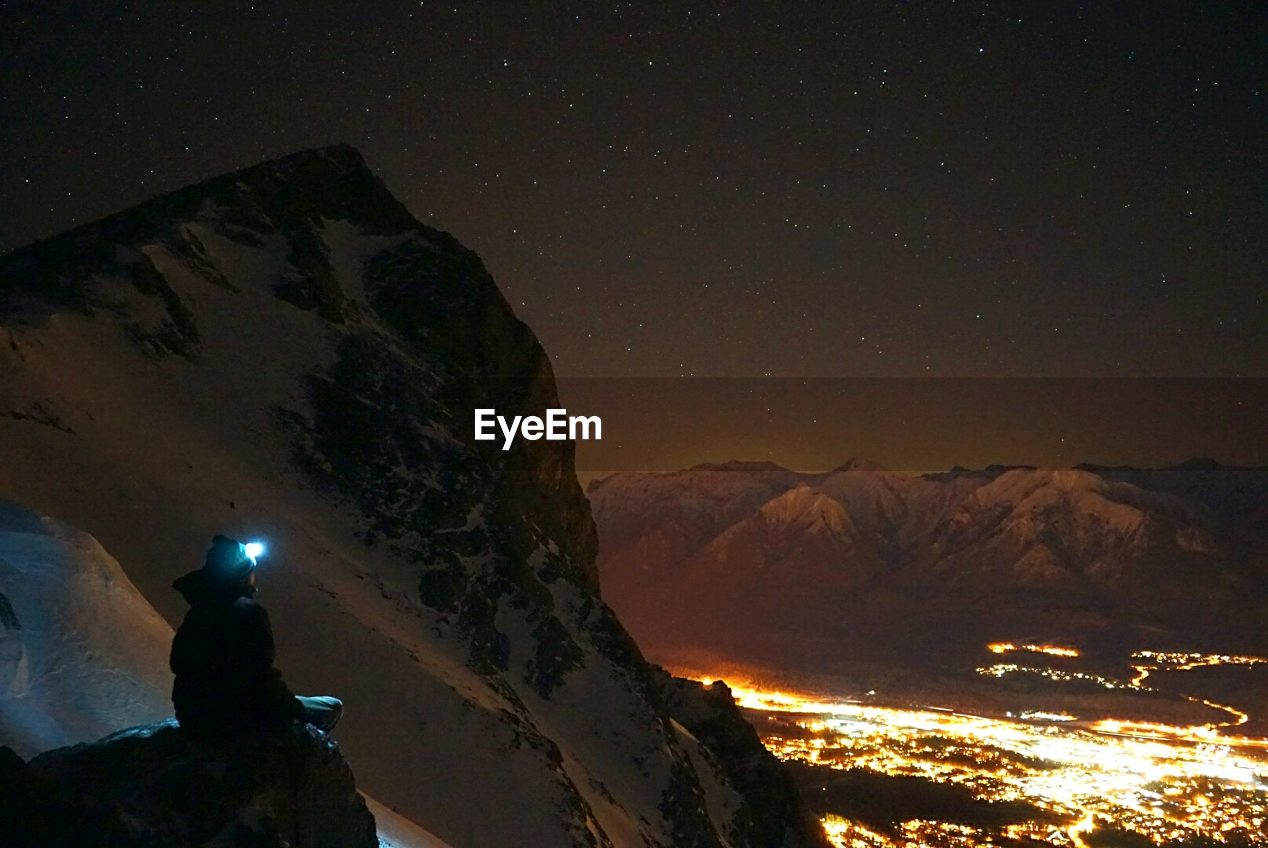 mountain, night, mountain range, scenics, snow, tranquil scene, tranquility, beauty in nature, winter, sky, landscape, illuminated, cold temperature, nature, rock formation, clear sky, silhouette, exploration, idyllic, physical geography
