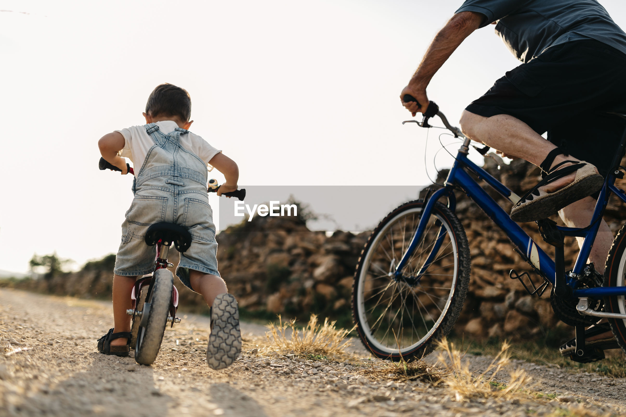 BOYS RIDING BICYCLE ON SWING