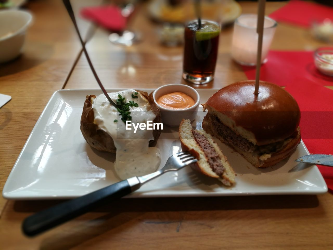 Close-up of hamburger in plate on table