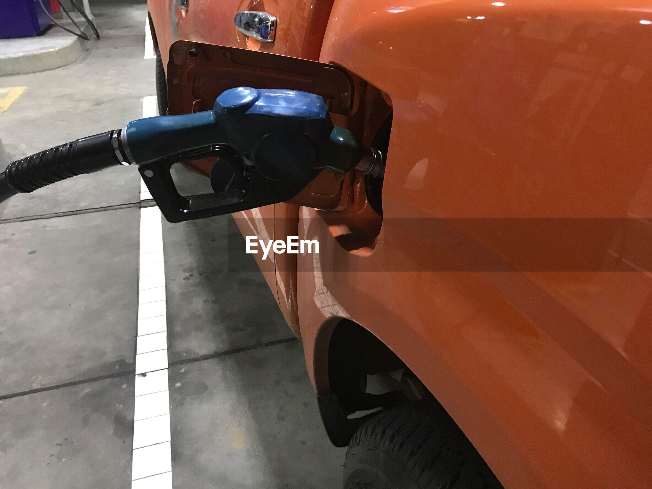 Close-up of car refueling at fuel pump