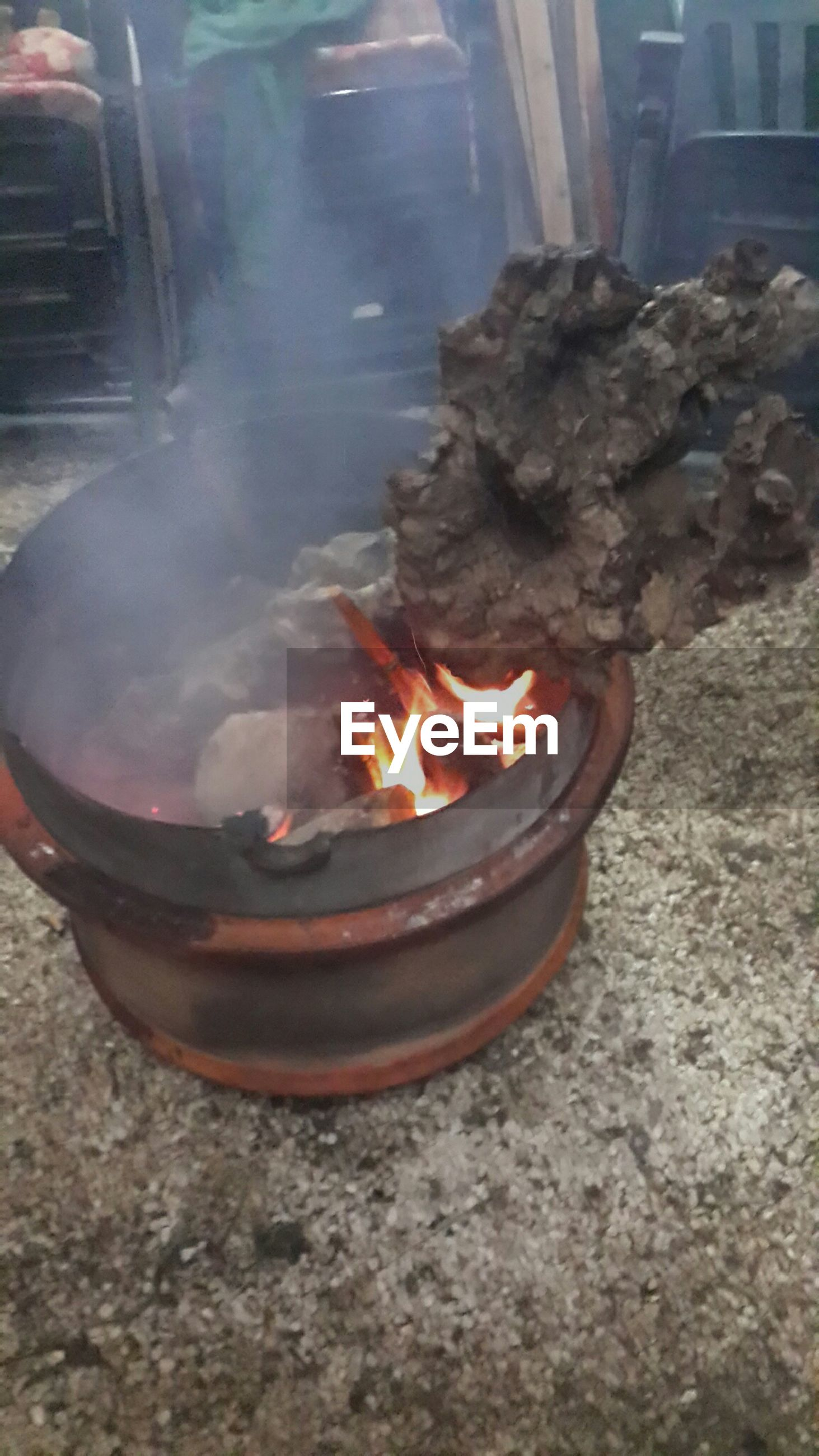 flame, burning, heat - temperature, fire - natural phenomenon, fire, glowing, close-up, heat, bonfire, indoors, motion, candle, night, firewood, high angle view, no people, preparation, illuminated, smoke - physical structure