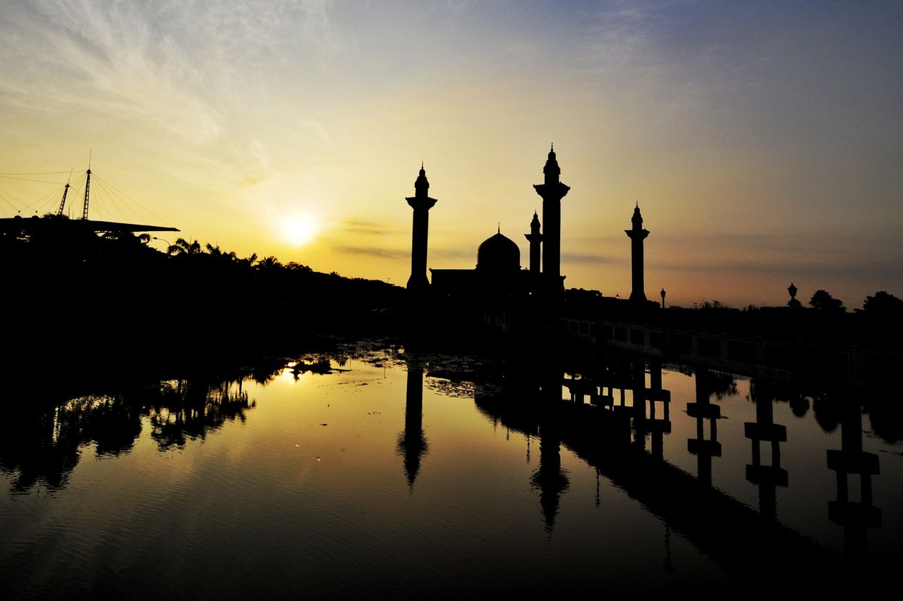 reflection, sky, architecture, sunset, built structure, water, nature, silhouette, lake, sun, travel destinations, waterfront, building exterior, tourism, no people, travel, religion, belief, history, outdoors