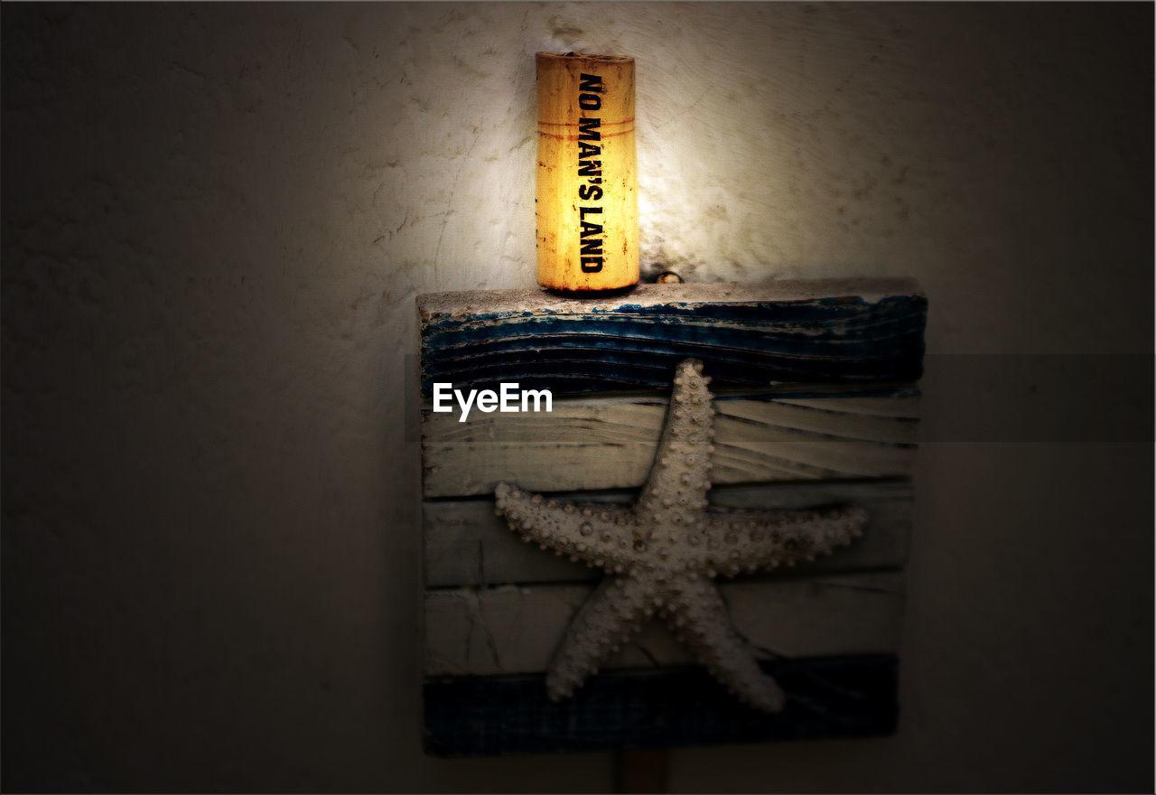 indoors, text, no people, communication, close-up, illuminated, night