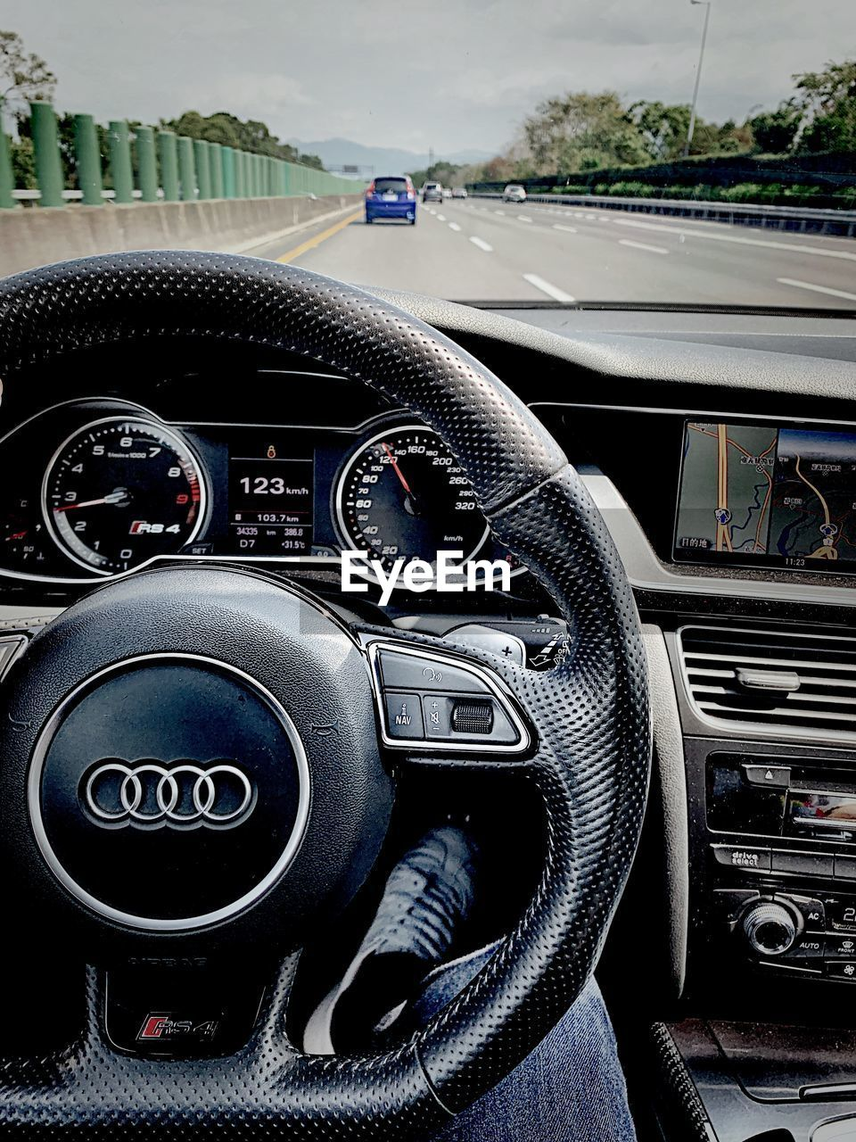 transportation, mode of transportation, car, vehicle interior, motor vehicle, land vehicle, car interior, control panel, control, steering wheel, dashboard, number, day, close-up, travel, gearshift, speedometer, black color, one person, outdoors