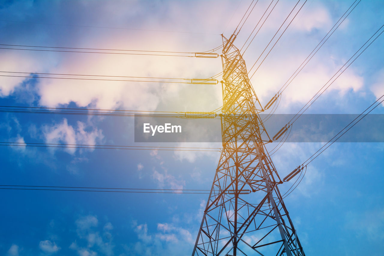 sky, low angle view, cloud - sky, electricity, cable, technology, fuel and power generation, electricity pylon, nature, power supply, connection, no people, power line, metal, day, outdoors, built structure, blue, tall - high, architecture, complexity, electrical equipment