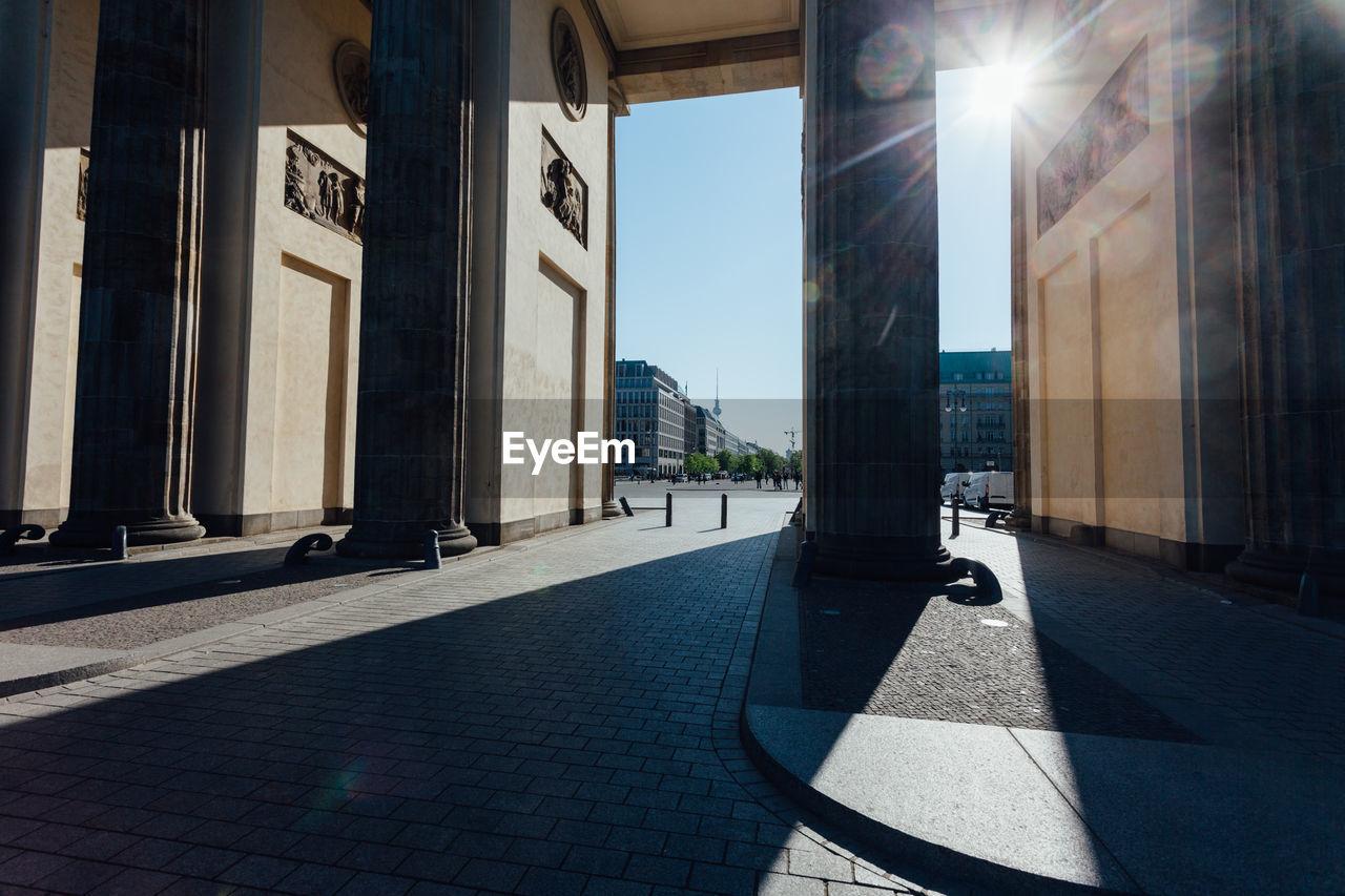 Brandenburg gate columns in city on sunny day