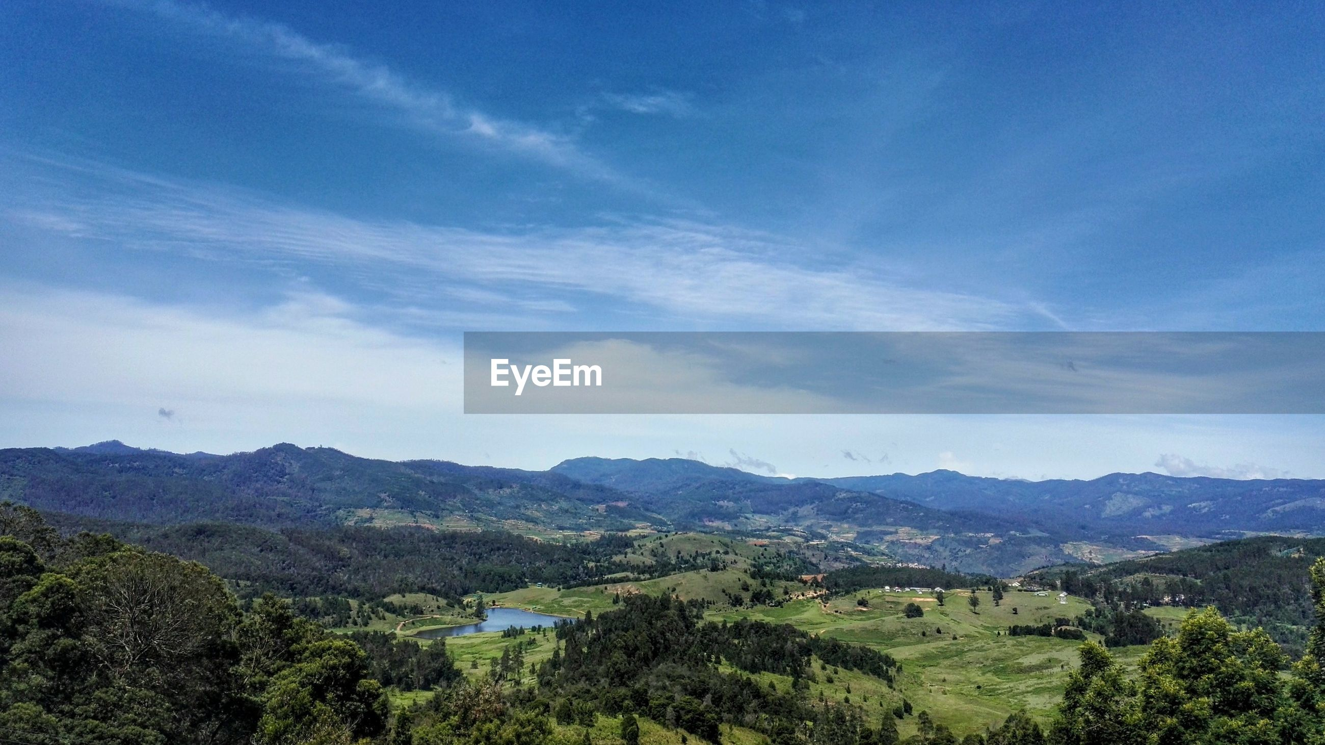 mountain, tranquil scene, scenics, tranquility, landscape, beauty in nature, mountain range, tree, sky, blue, nature, idyllic, non-urban scene, green color, cloud - sky, cloud, hill, day, outdoors, remote, lush foliage, growth, no people, horizon over land, non urban scene, green, majestic, tourism, elevated view
