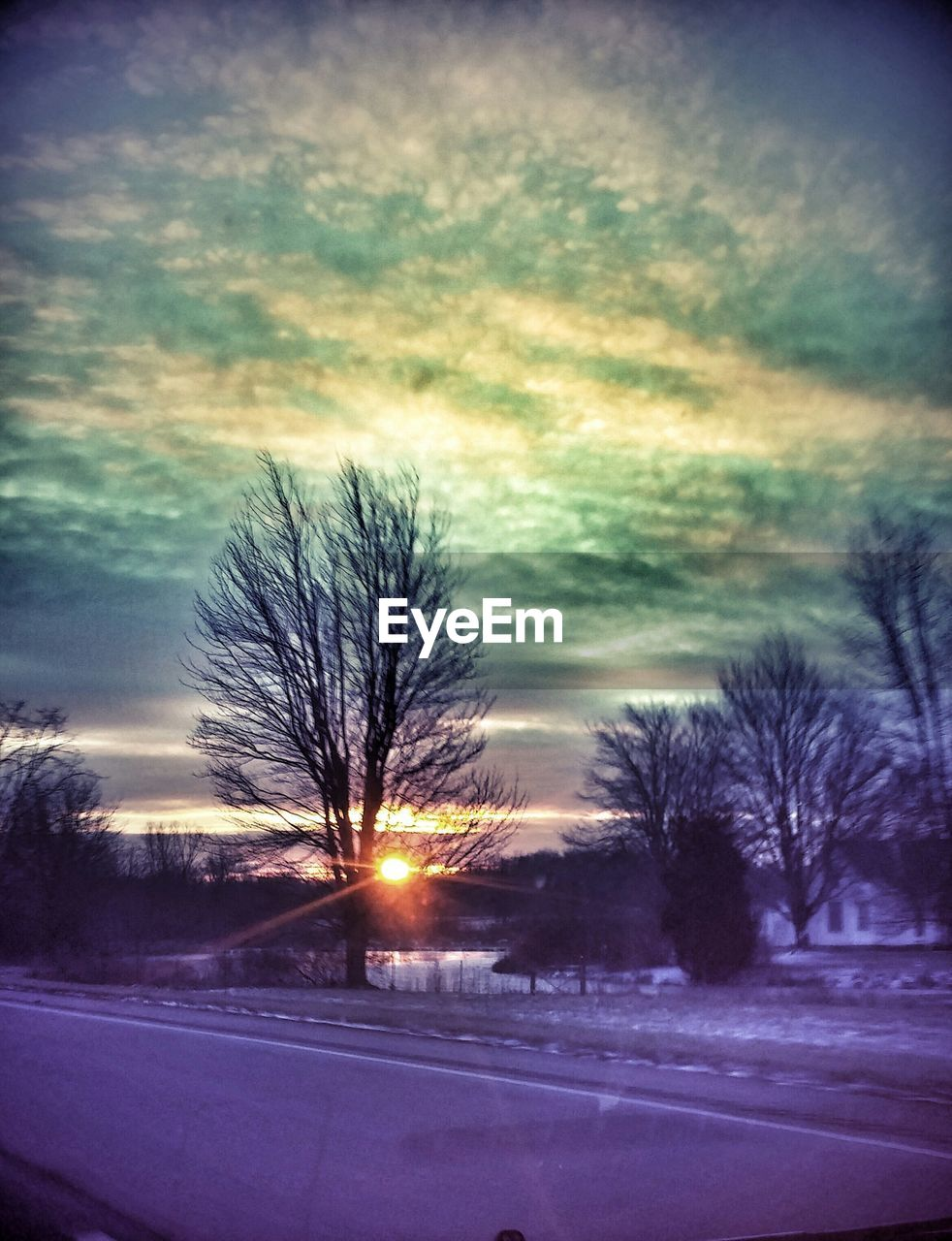 tree, weather, sky, cloud - sky, bare tree, snow, road, nature, dramatic sky, winter, dusk, scenics, sunset, car, cold temperature, beauty in nature, landscape, no people, outdoors, silhouette, night, tranquility, illuminated, storm cloud