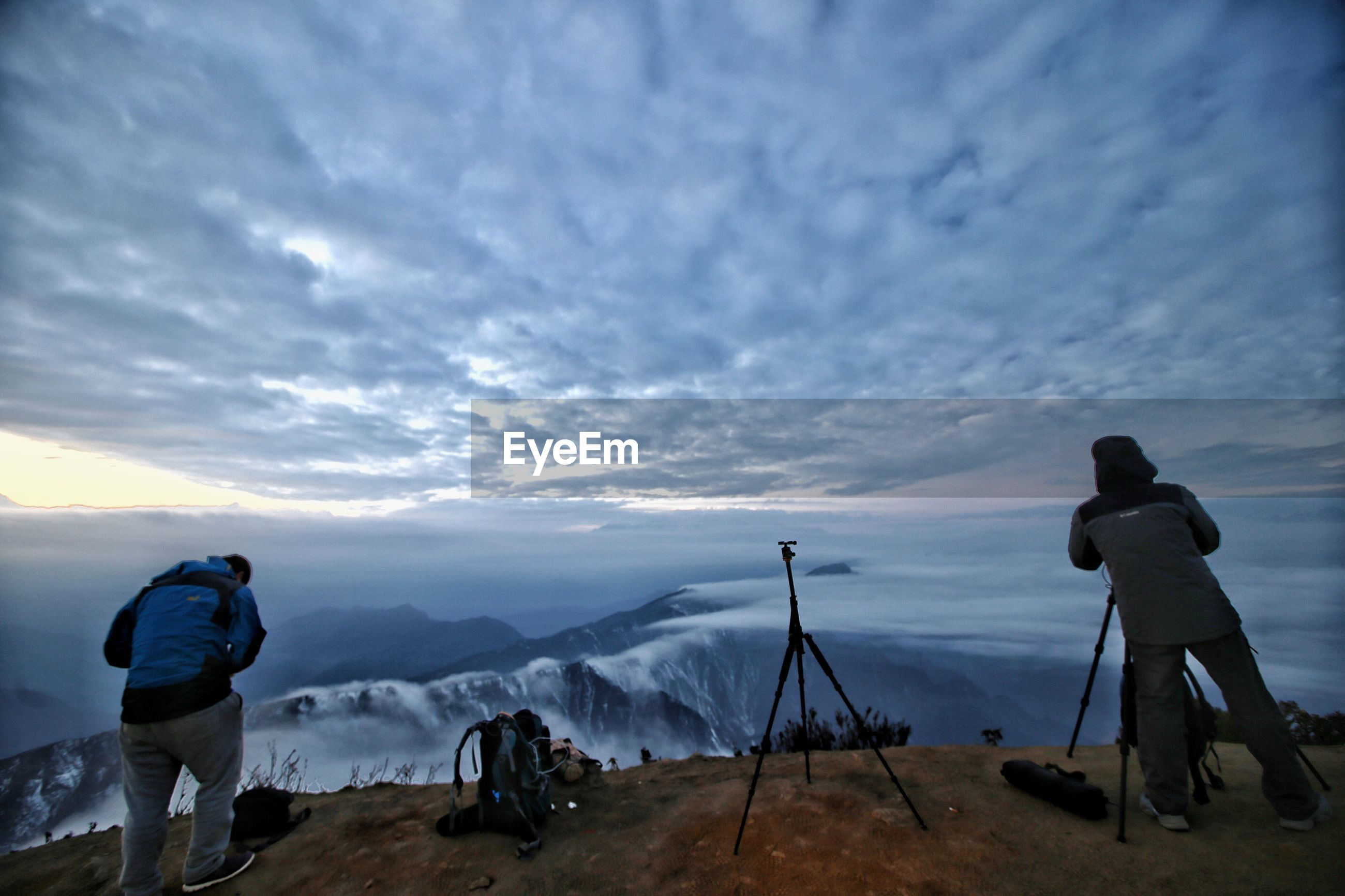sky, mountain, cloud - sky, men, lifestyles, leisure activity, weather, mountain range, scenics, tranquility, tranquil scene, cloudy, rear view, beauty in nature, landscape, nature, cloud, full length