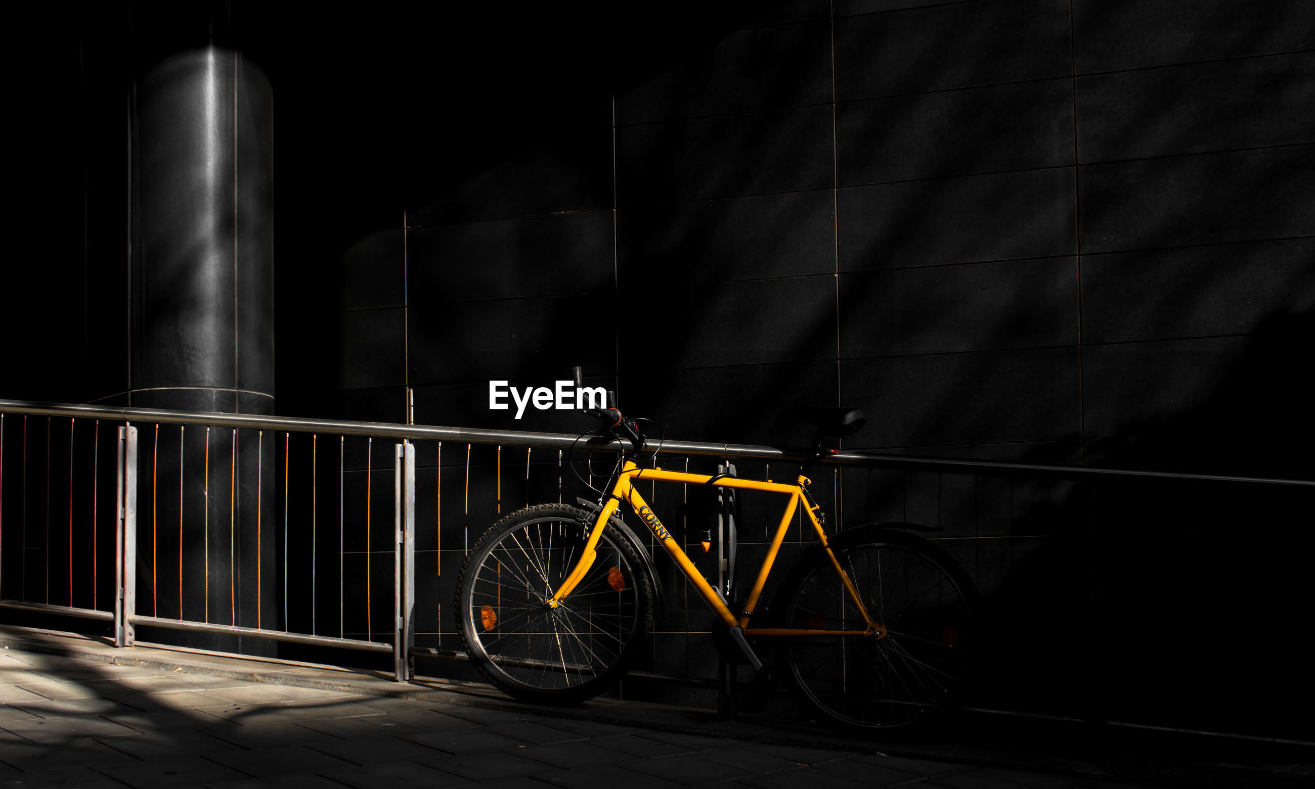 transportation, bicycle, mode of transportation, night, land vehicle, no people, stationary, metal, architecture, wheel, built structure, outdoors, dark, building exterior, illuminated, nature, parking, city, railing, travel, spoke