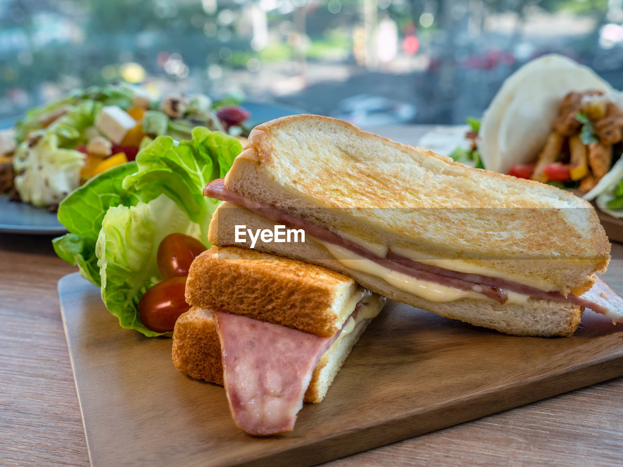 food and drink, food, bread, freshness, sandwich, ready-to-eat, meat, close-up, vegetable, focus on foreground, healthy eating, table, indoors, still life, wellbeing, no people, processed meat, ham, serving size, slice, snack, breakfast, temptation