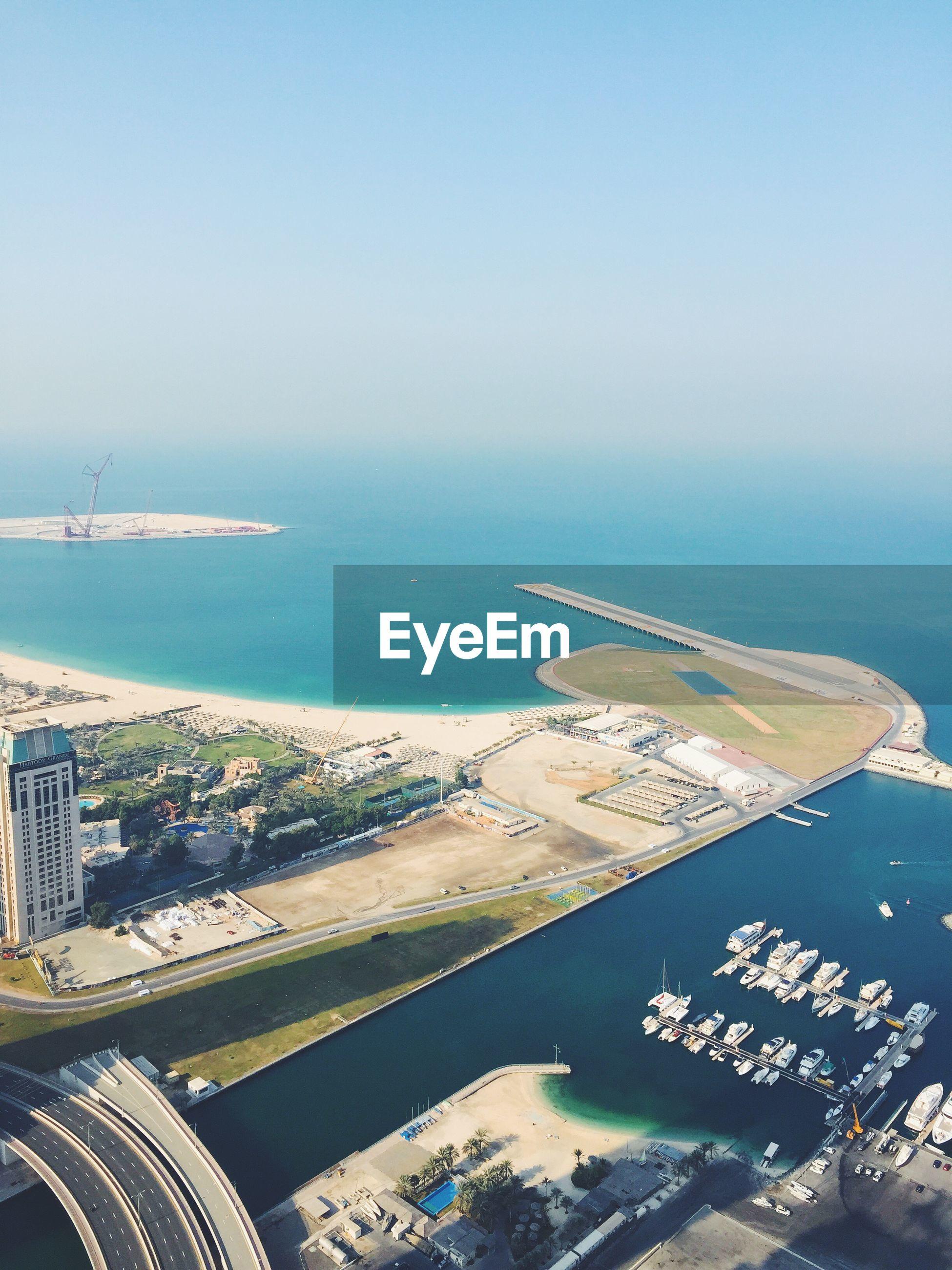 Elevated view of coastline and marina