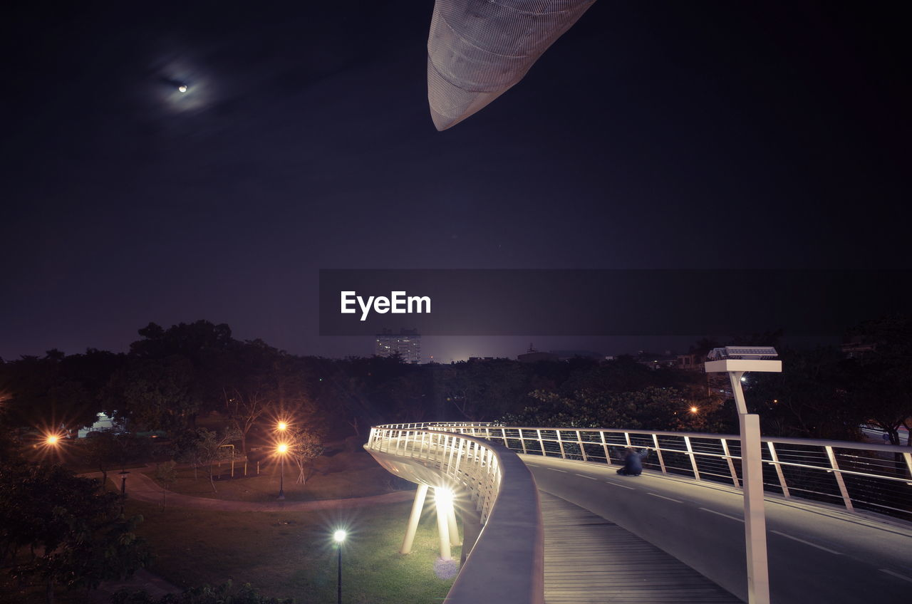 Illuminated Bridge Against Clear Sky At Night