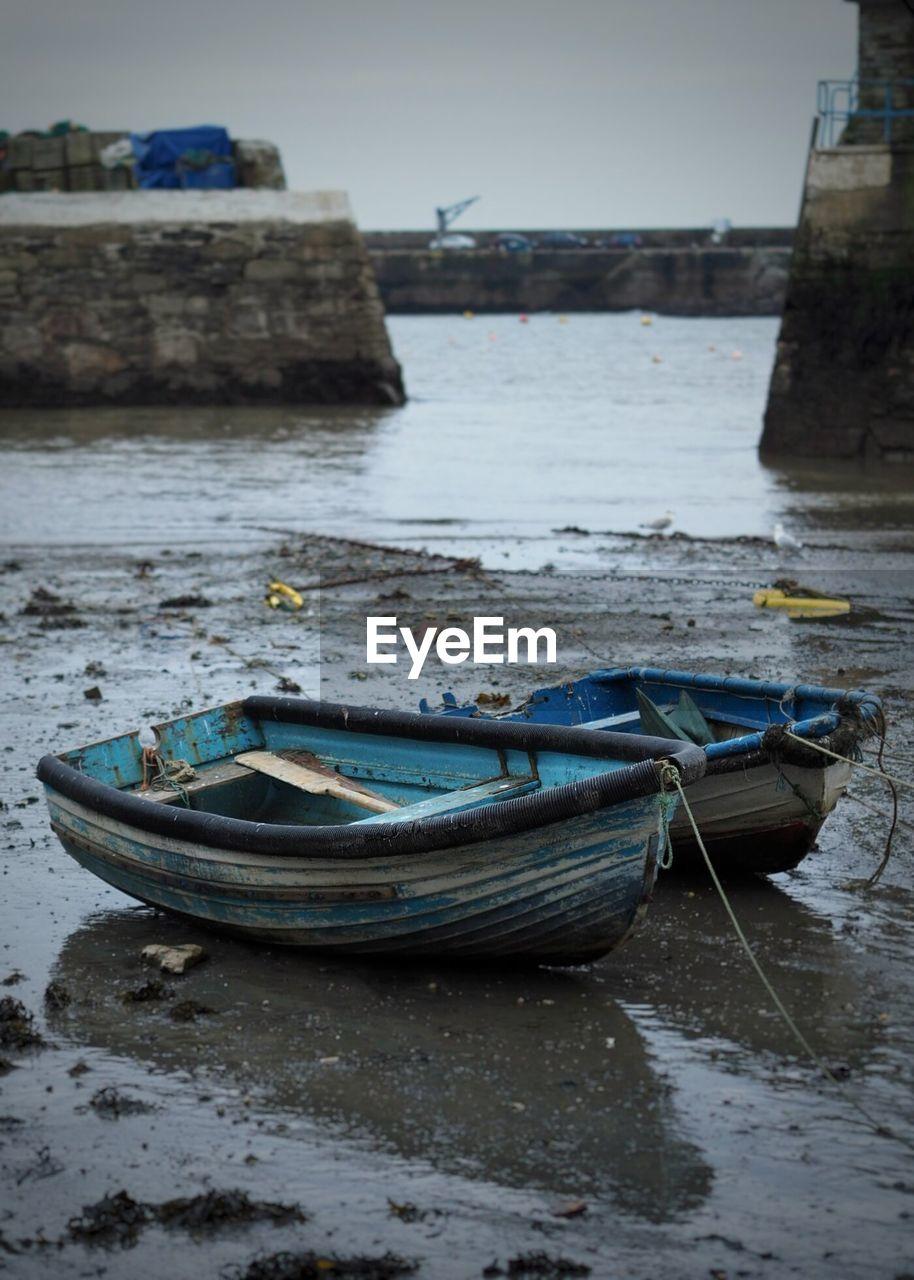 Old Boat Moored At Sea Shore
