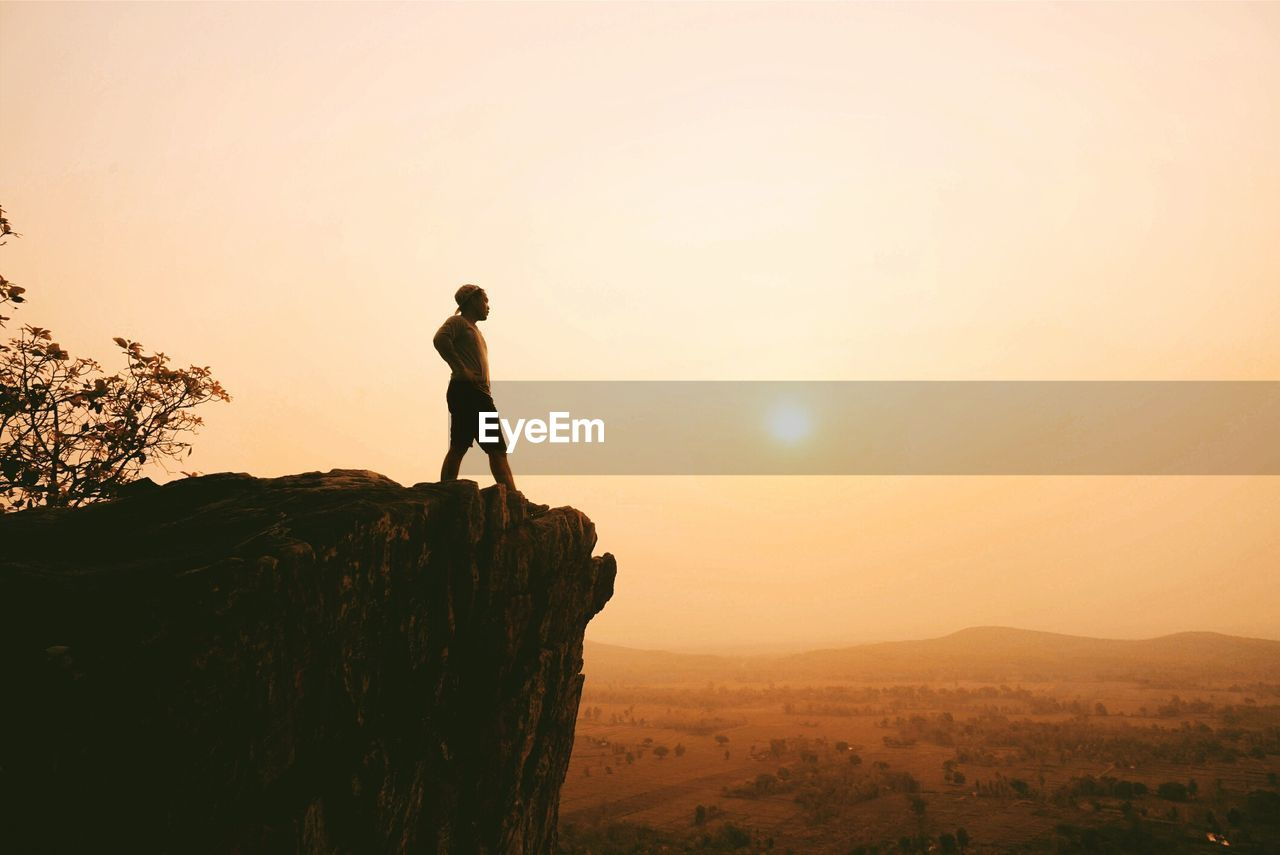 Silhouette Of Man On Cliff