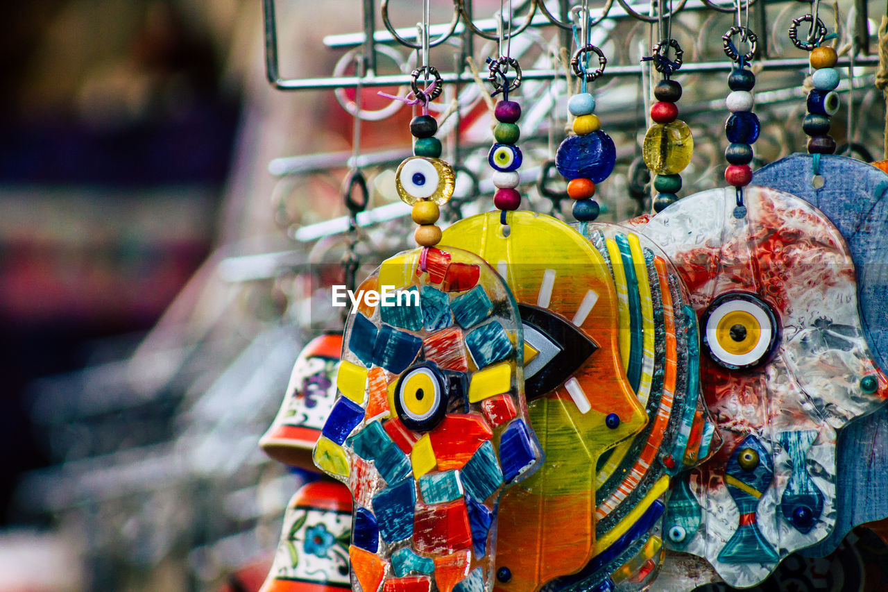 Close-up of multi colored dreamcatchers hanging for sale in market