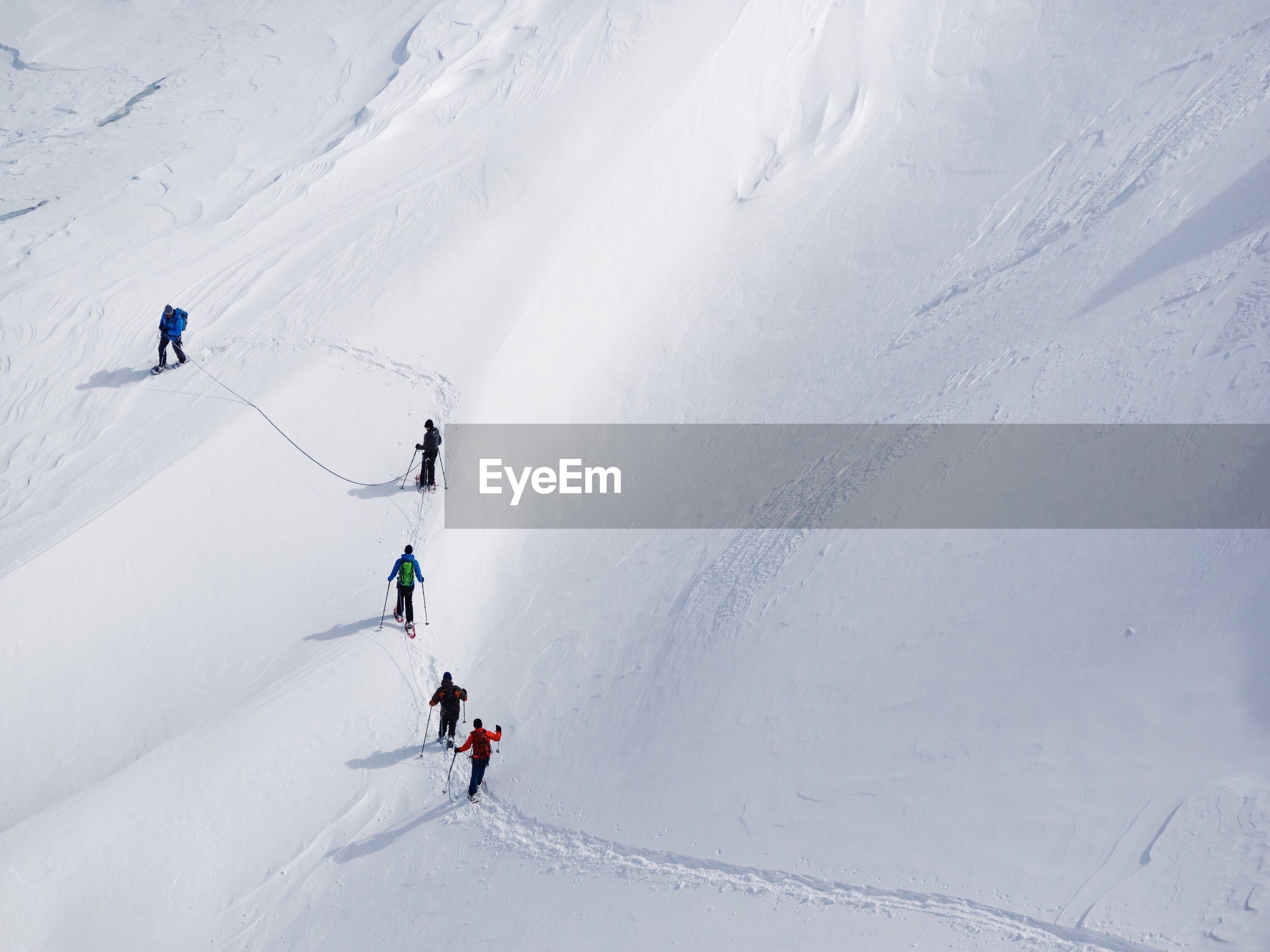 snow, sport, cold temperature, winter, winter sport, adventure, skiing, leisure activity, mountain, white color, real people, vacations, beauty in nature, holiday, trip, mountain range, scenics - nature, people, lifestyles, freedom, ski holiday, snowcapped mountain, outdoors