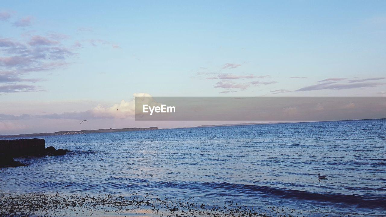 sea, water, sky, scenics - nature, beauty in nature, beach, horizon over water, horizon, land, cloud - sky, tranquility, tranquil scene, nature, sunset, non-urban scene, idyllic, no people, outdoors, wave