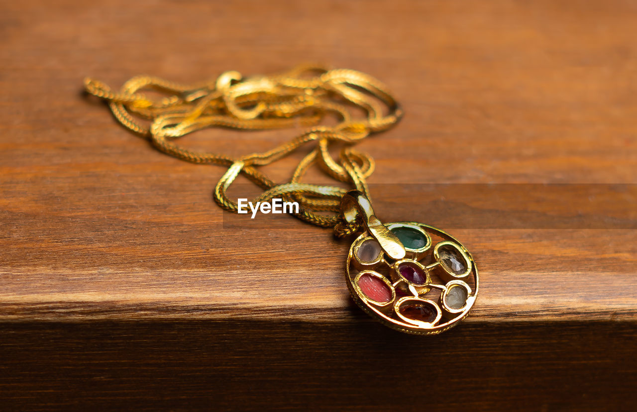 Close-up of necklace on wooden table