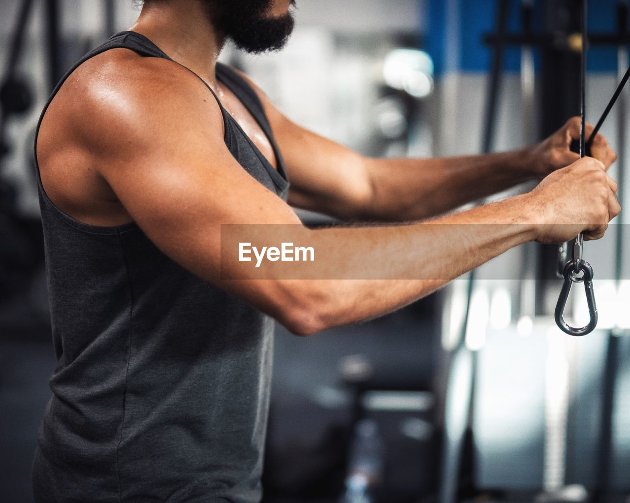 Midsection Of Young Man Exercising In Gym