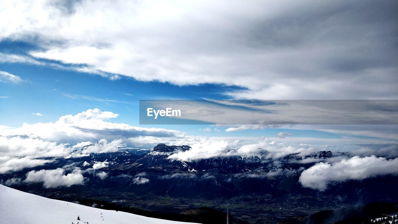 cloud - sky, sky, scenics - nature, beauty in nature, tranquil scene, tranquility, no people, day, environment, nature, non-urban scene, transportation, landscape, mode of transportation, idyllic, white color, outdoors, mountain, travel, above