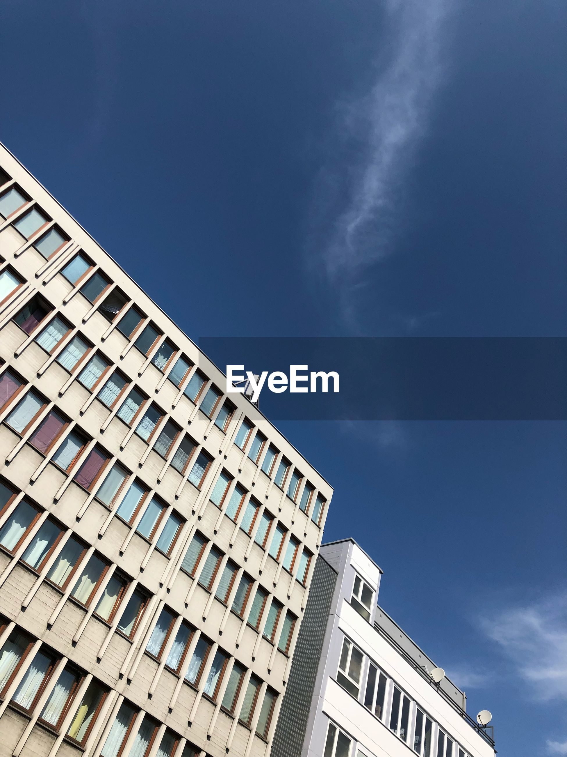 Low angle view of building against sky during sunny day