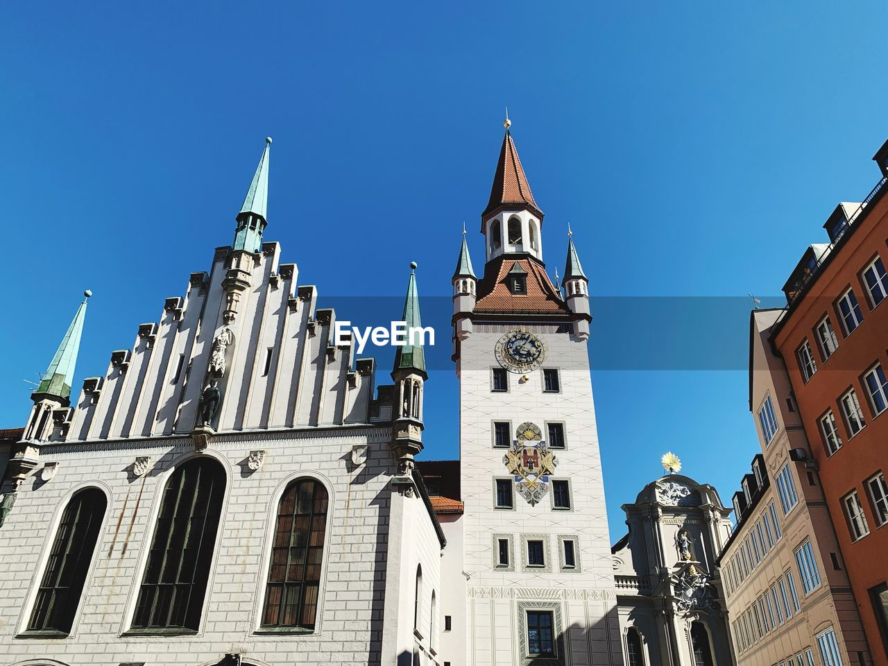 building exterior, built structure, sky, architecture, low angle view, building, religion, belief, spirituality, place of worship, tower, clear sky, blue, nature, travel destinations, no people, sunlight, day, clock, tall - high, spire, outdoors, gothic style