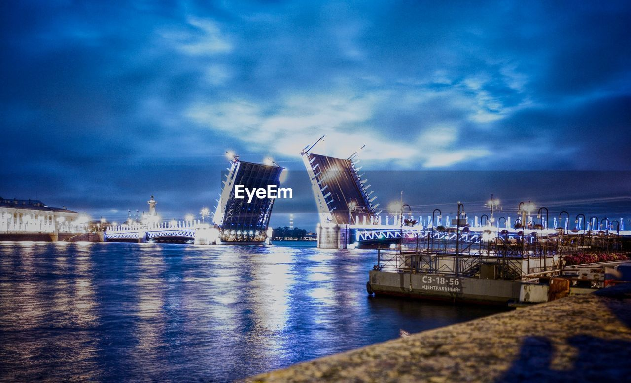 water, sky, architecture, cloud - sky, built structure, building exterior, waterfront, no people, harbor, nautical vessel, city, illuminated, outdoors, sea, blue, night, modern, travel destinations, cityscape, nature, skyscraper, shipyard