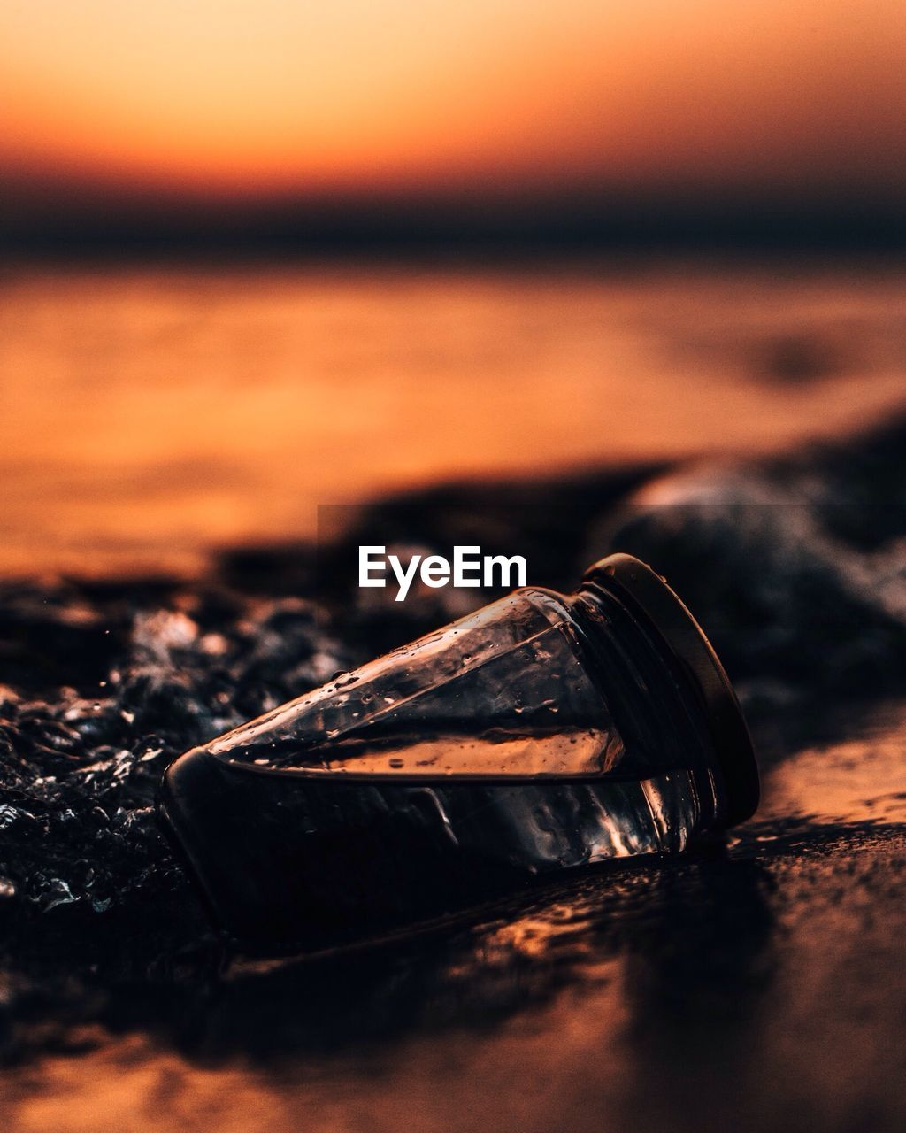 selective focus, close-up, sunset, no people, wood - material, nature, sky, still life, water, land, metal, outdoors, social issues, orange color, beach, sea, beauty in nature, abandoned, old