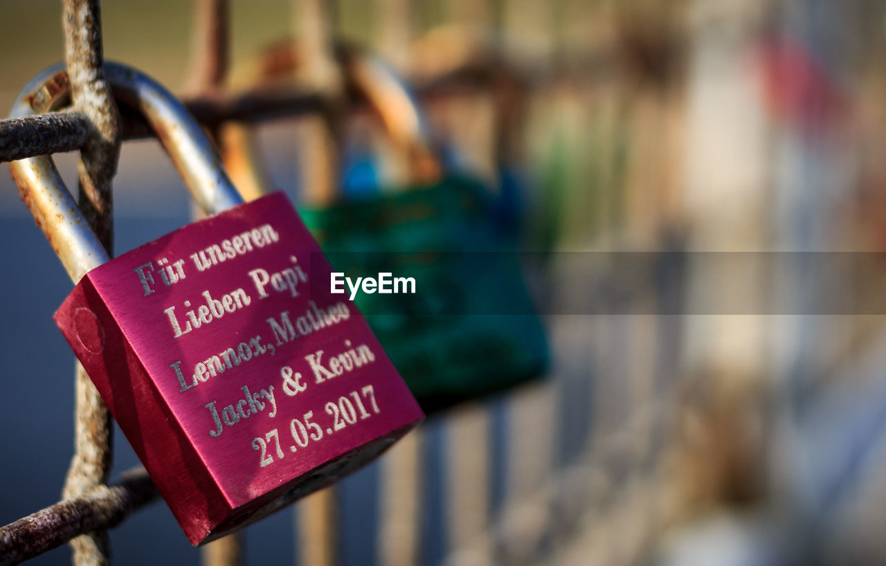 hanging, padlock, text, metal, focus on foreground, security, love lock, lock, close-up, communication, day, no people, railing, outdoors, safety, love, hope