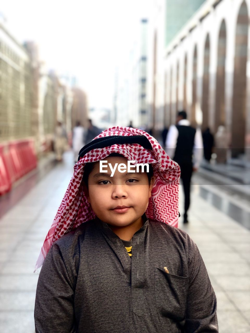 Portrait Of Cute Boy Wearing Traditional Clothing In City
