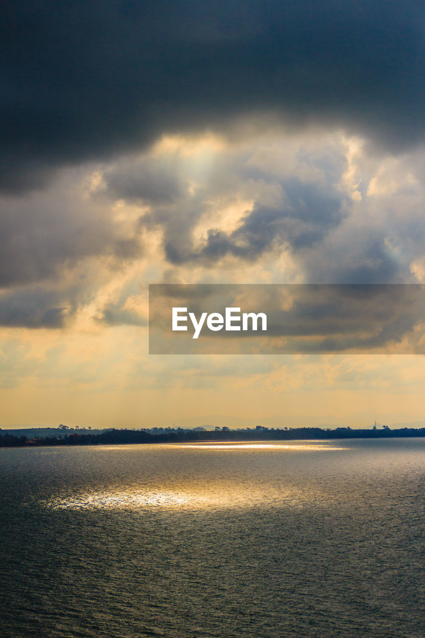 sky, cloud - sky, scenics - nature, water, beauty in nature, sunset, tranquility, tranquil scene, sea, waterfront, nature, no people, idyllic, horizon, outdoors, non-urban scene, horizon over water, overcast, ominous