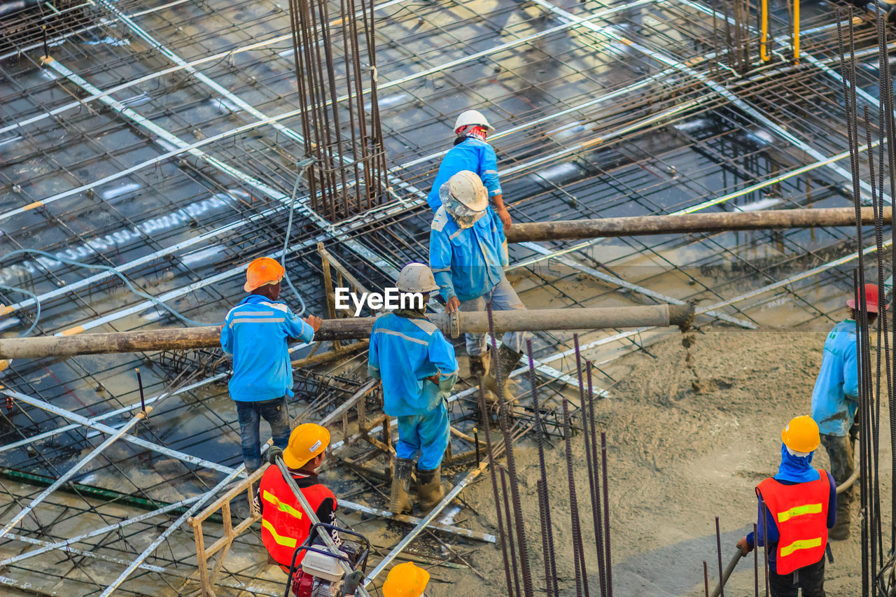 cooperation, teamwork, industry, working, group of people, occupation, headwear, hardhat, helmet, coworker, safety, standing, men, protective workwear, protection, males, mature men, hat, mature adult