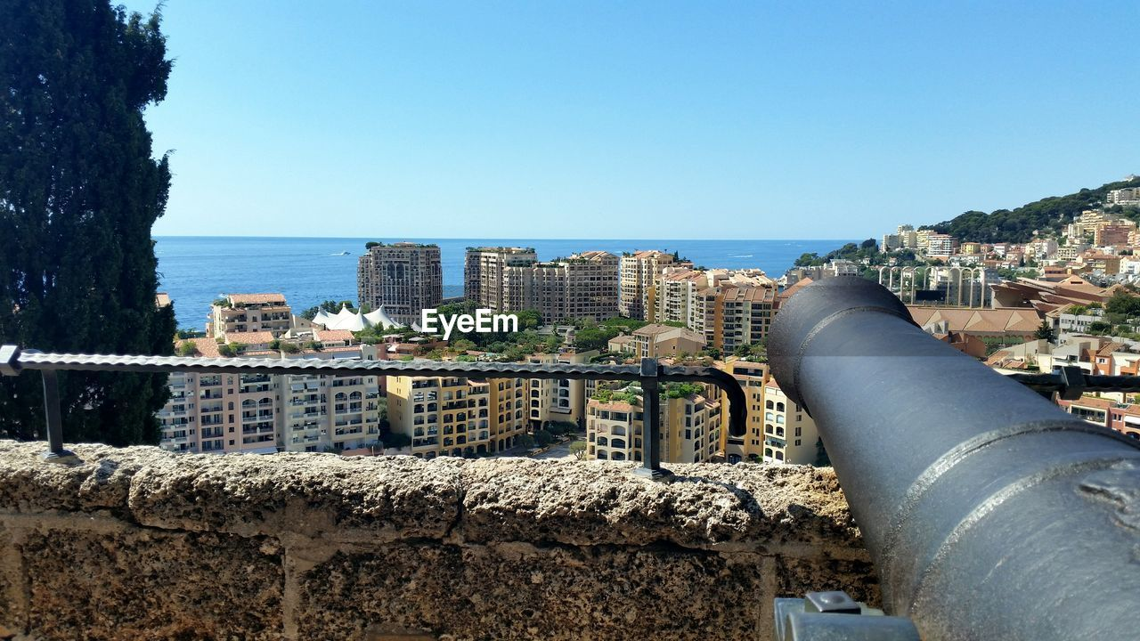 architecture, built structure, building exterior, sea, clear sky, day, water, outdoors, blue, horizon over water, retaining wall, nature, sky, no people, cityscape, city, close-up