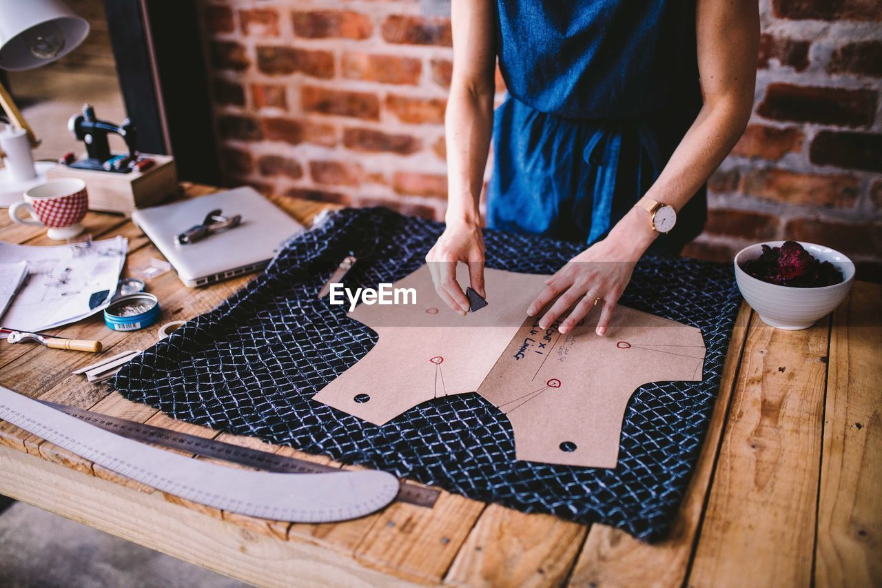 Midsection Of Woman Working At Table In Workshop
