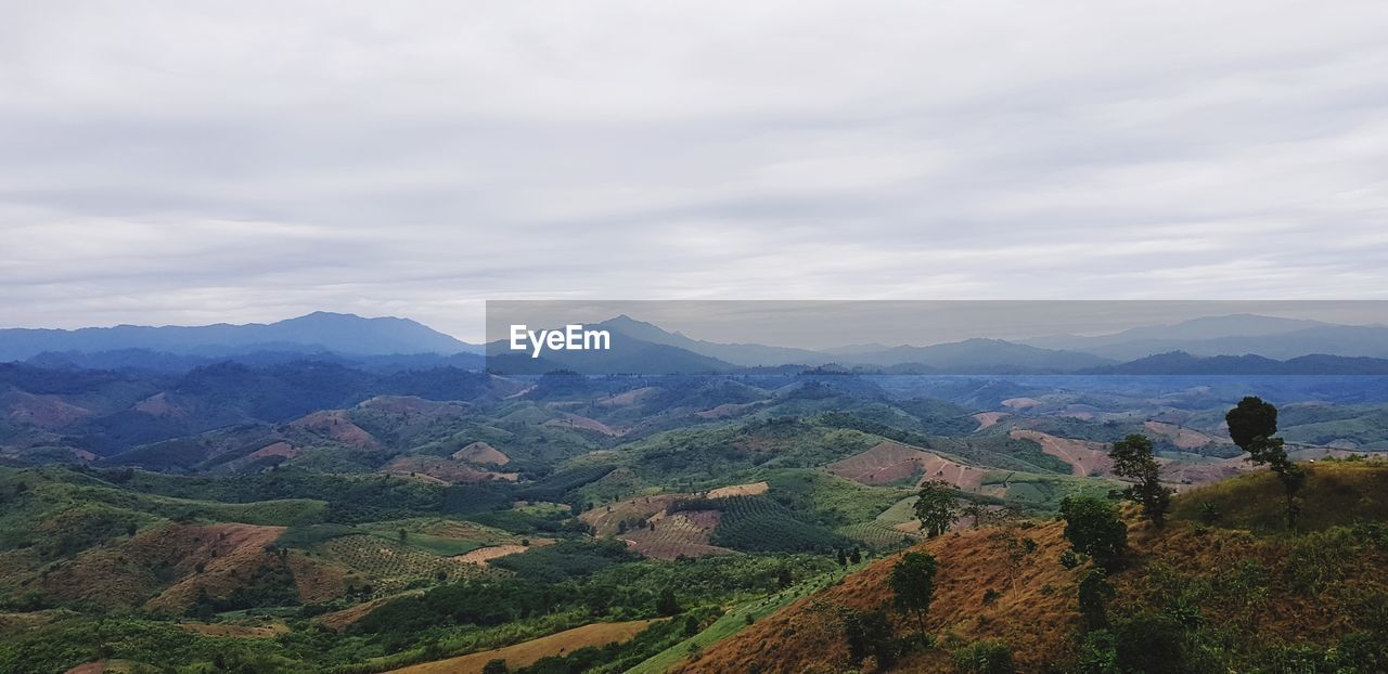 mountain, scenics - nature, beauty in nature, sky, cloud - sky, tranquil scene, mountain range, tranquility, environment, landscape, non-urban scene, idyllic, real people, nature, leisure activity, one person, day, remote, adventure, outdoors, looking at view