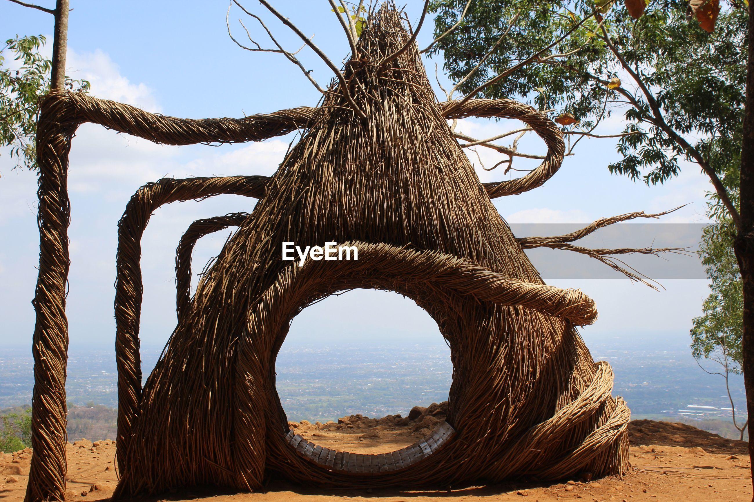 Thatched roof hut against landscape