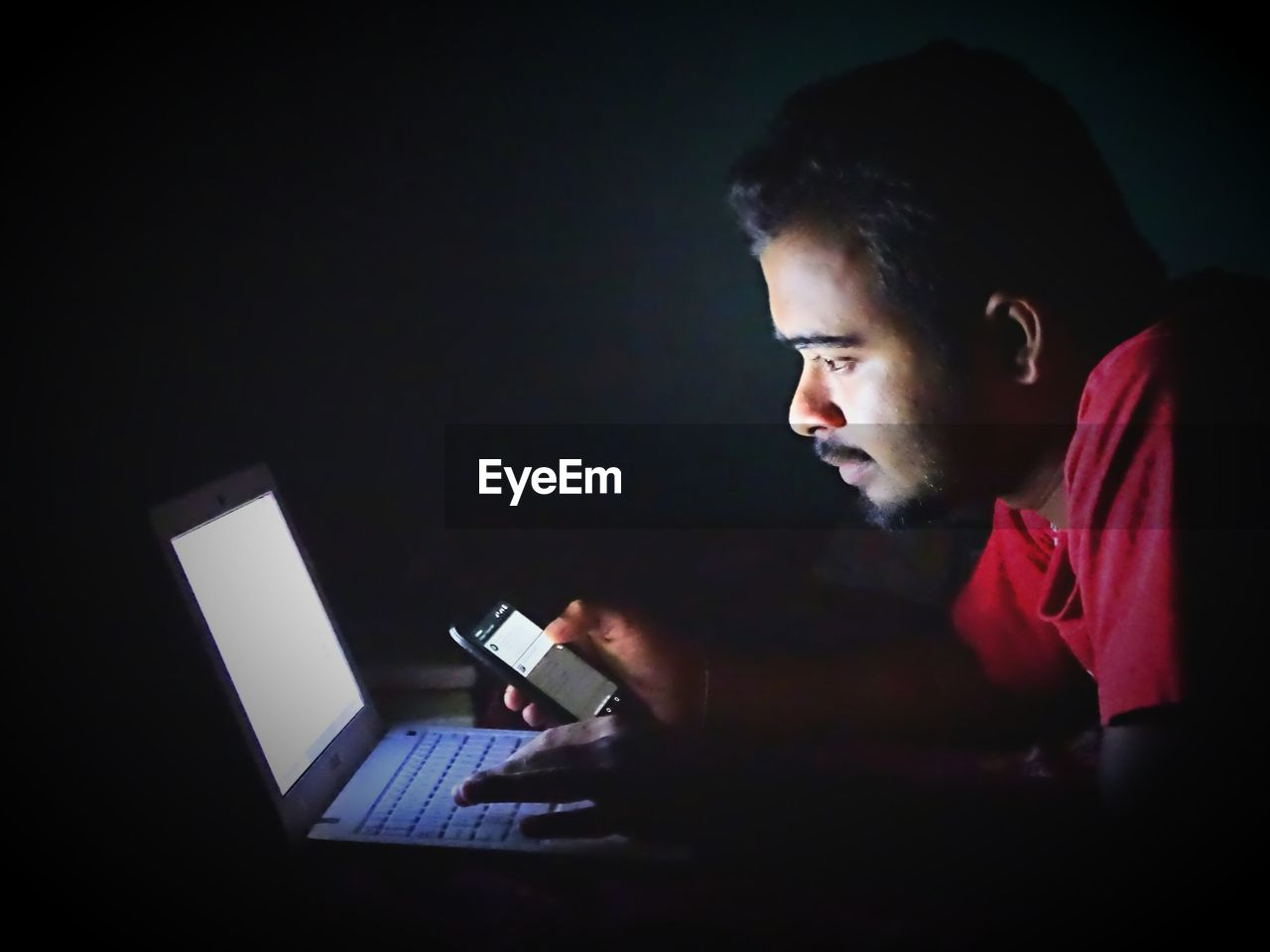 technology, wireless technology, laptop, using laptop, connection, one person, communication, computer, indoors, internet, real people, side view, lifestyles, night, young adult, close-up, people