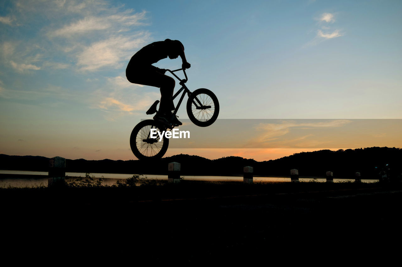 Silhouette Of Man On Bmx Bicycle