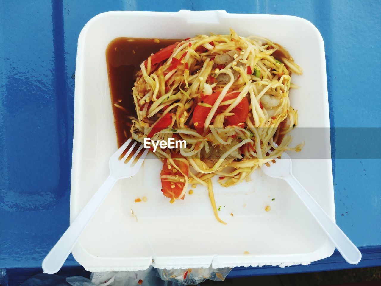 Noodles in bowl on table