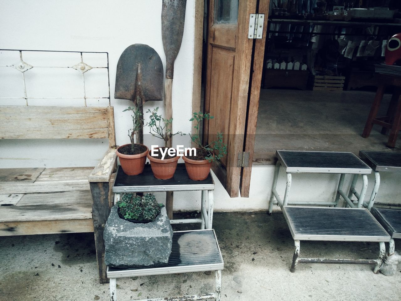 seat, no people, chair, absence, shelf, choice, indoors, furniture, empty, variation, day, wood - material, potted plant, architecture, shoe, group of objects, in a row, nature, arrangement