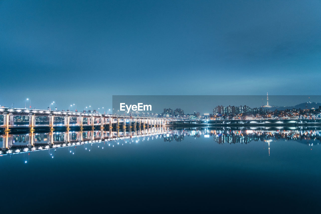 water, illuminated, sky, waterfront, architecture, nature, reflection, city, night, built structure, building exterior, copy space, no people, blue, scenics - nature, sea, cityscape, outdoors