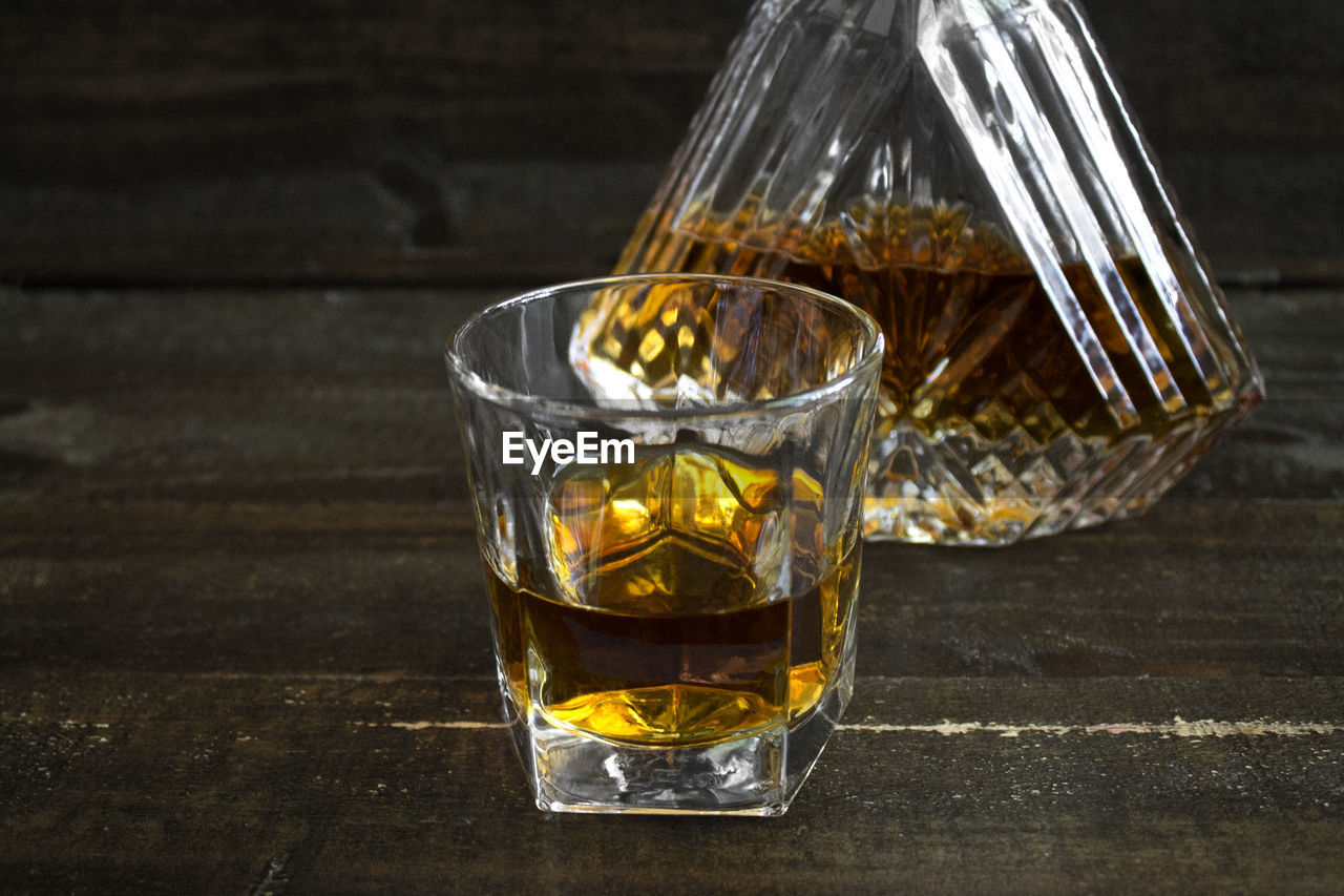 glass, food and drink, refreshment, table, drink, drinking glass, household equipment, transparent, whiskey, close-up, freshness, glass - material, no people, food, wood - material, alcohol, still life, indoors, focus on foreground