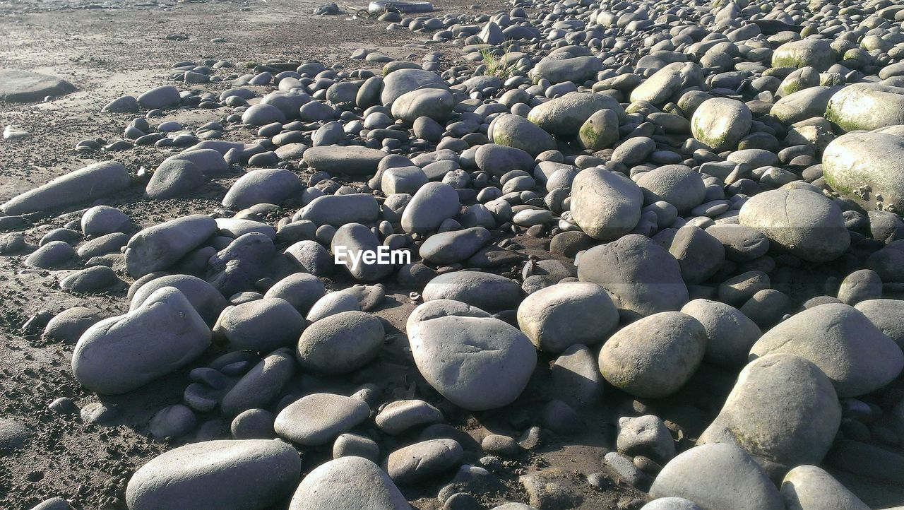 pebble, beach, shore, pebble beach, nature, beauty in nature, no people, outdoors, day, sand, sunlight, tranquility, sea, water