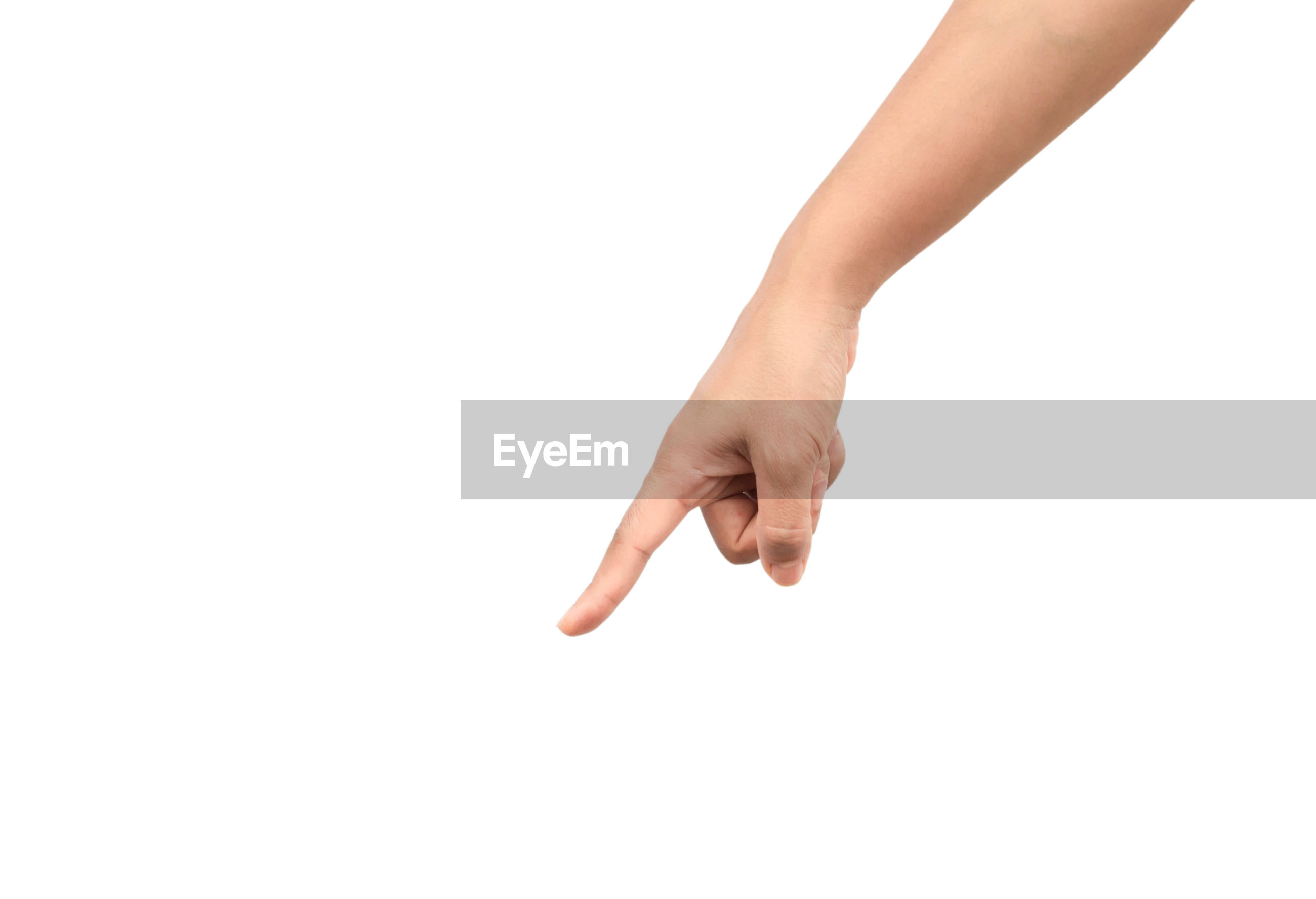 Close-up of human hand pointing against white background