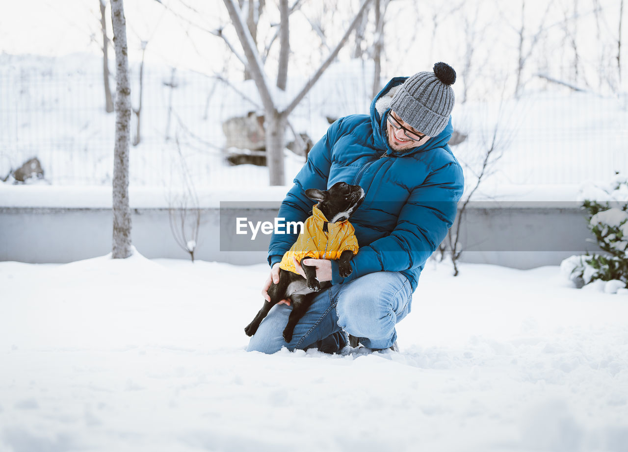 winter, cold temperature, snow, child, childhood, warm clothing, two people, clothing, boys, males, full length, leisure activity, family, real people, lifestyles, men, nature, parent, day, son, outdoors
