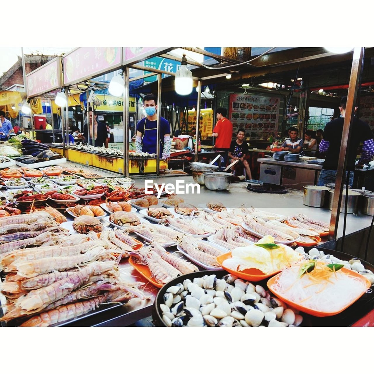 food, market stall, food and drink, real people, seafood, market, men, outdoors, choice, large group of people, day, freshness, people